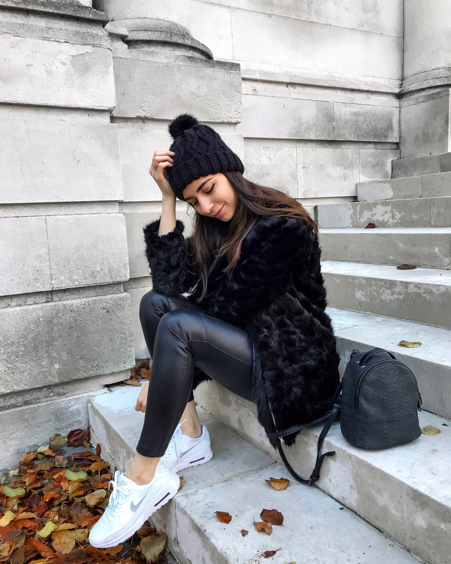 girl with fluffy jacket and hat and nike air max and little backpack and leather leggings